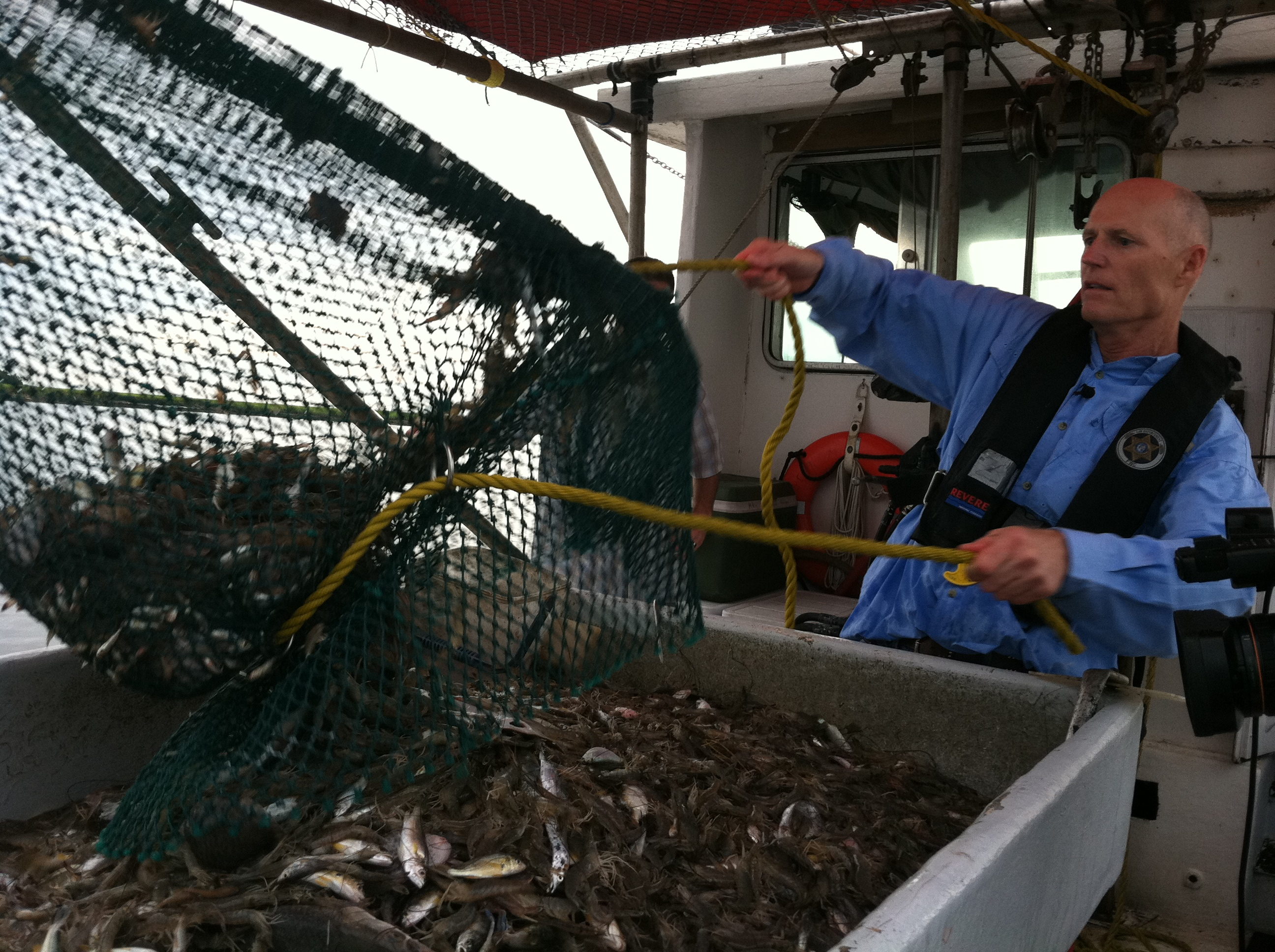 governor scott gets to work as shrimp boat striker